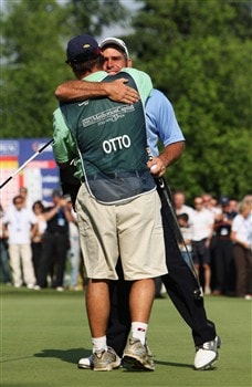 MILAN, ITALY - MAY 11:  Hennie Otto of South Africa  celebrates with his caddie after holing his winning putt on the 18th hole during the final round of the MC Methorios Capital Italian Open Golf at The Castello Di Tolcinasco Golf Club on May 11, 2008 in Milan, Italy.  (Photo by Stuart Franklin/Getty Images)
