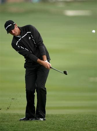 PEBBLE BEACH, CA - FEBRUARY 12: Dustin Johnson chips onto the green on the 18th hole during the first round of the the AT&T Pebble Beach National Pro-Am on Pebble Beach Golf Links on February 12, 2009 in Pebble Beach, California. (Photo by Stephen Dunn/Getty Images)