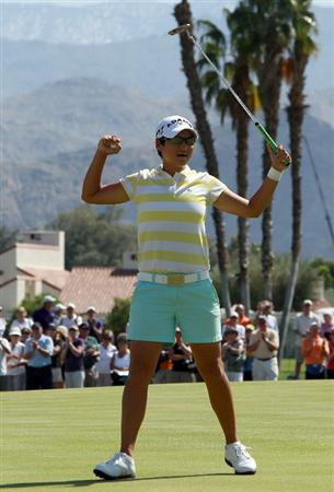 RANCHO MIRAGE, CA - APRIL 04:  Yani Tseng of Taiwan celebrates after holing the winning putt on the 18th green during the final round of the 2010 Kraft Nabisco Championship, on the Dinah Shore Course at The Mission Hills Country Club, on April 4, 2010 in Rancho Mirage, California.  (Photo by David Cannon/Getty Images)