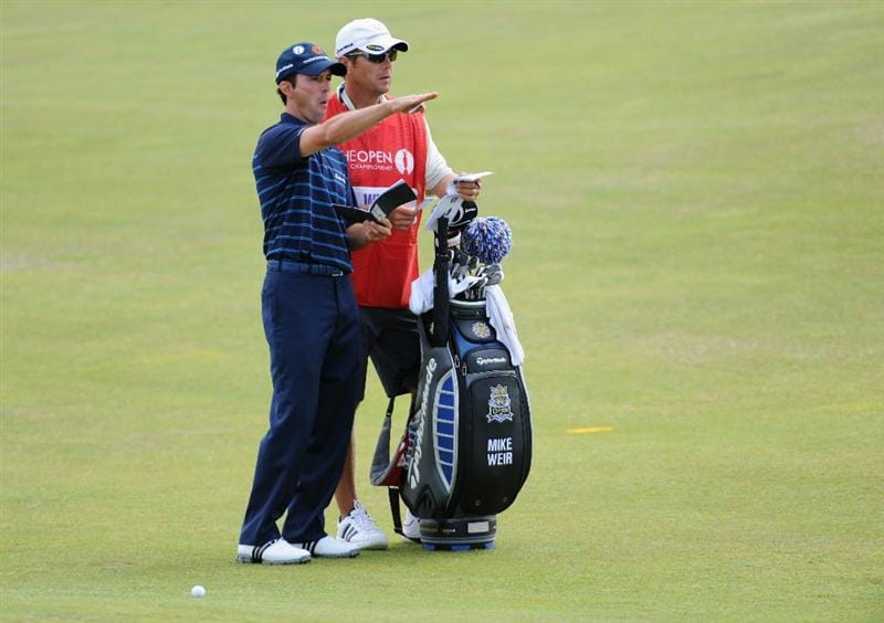 TURNBERRY, SCOTLAND - JULY 16:  Mike Weir of Canada lines up a shot with his caddie Brennan Little during round one of the 138th Open Championship on the Ailsa Course, Turnberry Golf Club on July 16, 2009 in Turnberry, Scotland.  (Photo by Harry How/Getty Images)