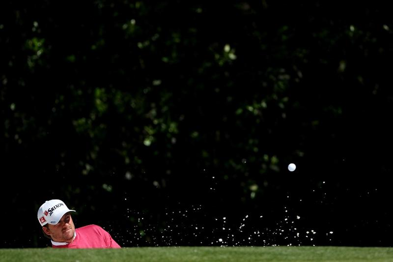 AUGUSTA, GA - APRIL 05:  Graeme McDowell of Northern Ireland plays a bunker shot during a practice round prior to the 2011 Masters Tournament at Augusta National Golf Club on April 5, 2011 in Augusta, Georgia.  (Photo by Andrew Redington/Getty Images)