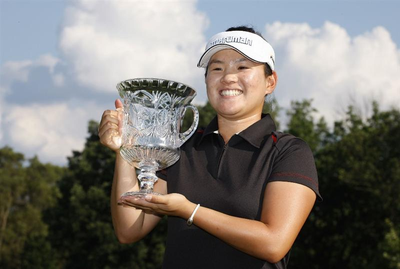 SYLVANIA, OH - JULY 05:  Eunjung Yi of South Korea holds up the trophy after winning the Jamie Farr Owens Corning Classic at Highland Meadows Golf Club on July 5, 2009 in Sylvania, Ohio.  (Photo by Gregory Shamus/Getty Images)