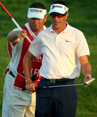 ABU DHABI, UNITED ARAB EMIRATES - JANUARY 16:  Robert Allenby of Australia receives some advice from his caddie Michael 'Sponge' Waite on the 15th hole during the second round of The Abu Dhabi Golf Championship at Abu Dhabi Golf Club on January 16, 2009 in Abu Dhabi, United Arab Emirates.  (Photo by Andrew Redington/Getty Images)
