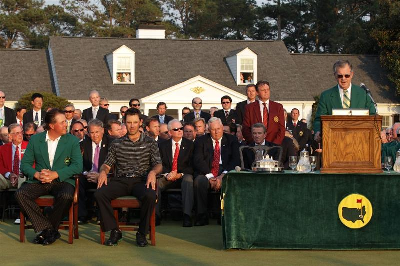 AUGUSTA, GA - APRIL 10:  Phil Mickelson and Charl Schwartzel of South Africa are seen at the green jacket presentation as William Porter Payne speaks to the gallery after Schwartzel's two-stroke victory at the 2011 Masters Tournament at Augusta National Golf Club on April 10, 2011 in Augusta, Georgia.  (Photo by David Cannon/Getty Images)