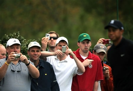 AUGUSTA, GA - APRIL 08:  Patrons take pictures of Tiger Woods during the second day of practice prior to the start of the 2008 Masters Tournament at Augusta National Golf Club on April 8, 2008 in Augusta, Georgia.  (Photo by Harry How/Getty Images)