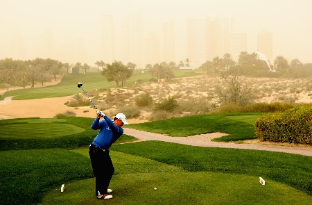 DUBAI, UNITED ARAB EMIRATES - FEBRUARY 01:  Graeme McDowell of Northern Ireland tees off on the eighth hole during the second round of the Dubai Desert Classic on the Majilis course at Emirates Golf Club on February 1, 2008 in Dubai, United Arab Emirates.  (Photo by Andrew Redington/Getty Images)