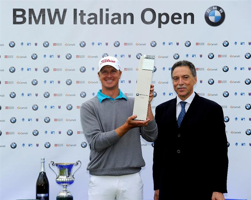 TURIN, ITALY - MAY 09:  Fredrik Andersson Hed of Sweden is presented with the winner's trophy by Gianni Oliosi, BMW Italy after the final round of the BMW Italian Open at Royal Park I Roveri on May 9, 2010 in Turin, Italy.  (Photo by Stuart Franklin/Getty Images)