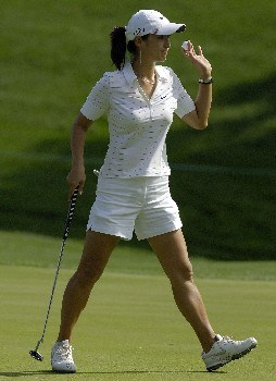 WILLIAMSBURG - MAY 10:  Grace Park of South Korea acknowledges the gallery after making a birdie putt on the 14th green in Round 1 of the LPGA Michelob Ultra Open at Kingsmill on May 10, 2007, in Williamsburg, Virginia. (Photo by Jonathan Ernst/Getty Images)