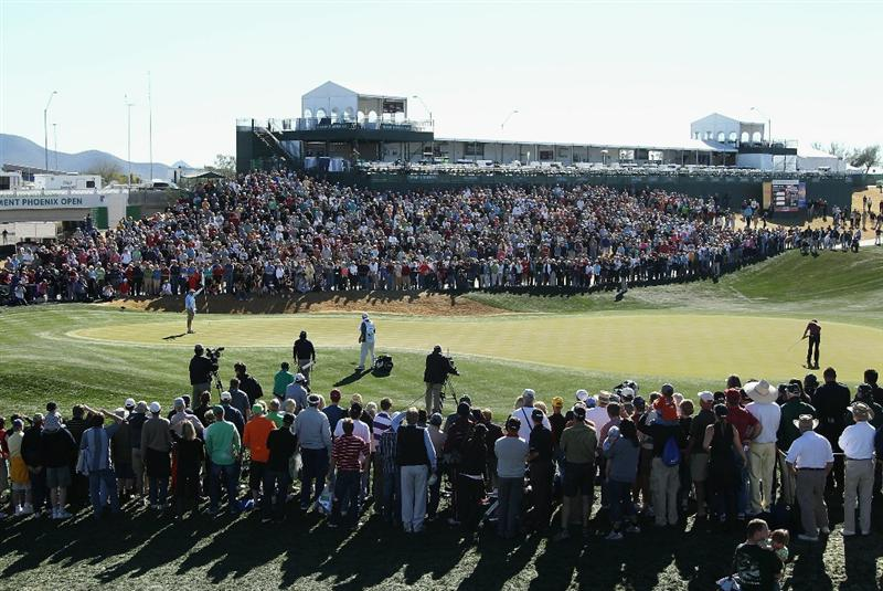 SCOTTSDALE, AZ - FEBRUARY 07:  Mark Wilson (R) putts on the 18th hole green during the first playoff hole against Jason Dufner in the Waste Management Phoenix Open at TPC Scottsdale on February 7, 2011 in Scottsdale, Arizona.  (Photo by Christian Petersen/Getty Images)