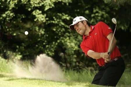Jose Manuel Lara blasts out of the bunker during the first round of the 2005 KLM Open at Hilversumsche Golf Club. June 9, 2005Photo by Pete Fontaine/WireImage.com