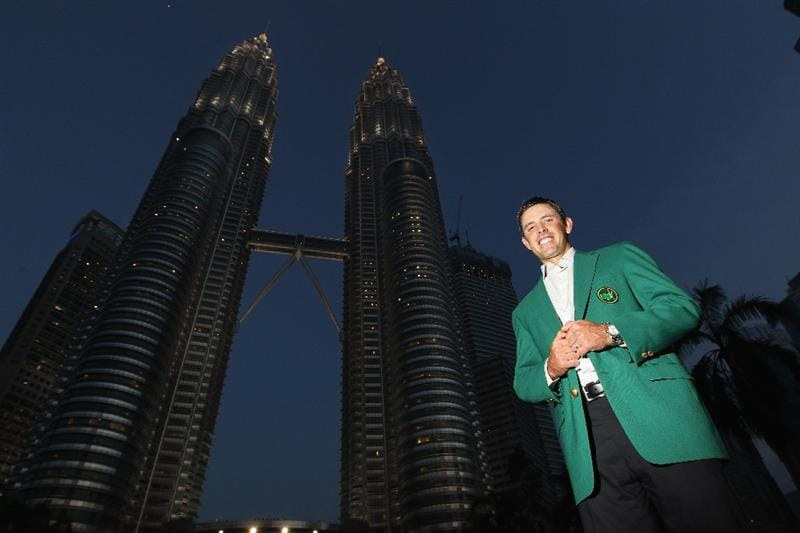 KUALA LUMPUR, MALAYSIA - APRIL 13:  Charl Schwartzel of South Africa poses for photos outside the Petronas Towers prior to the Maybank Malaysian Open at Kuala Lumpur Golf & Country Club on April 13, 2011 in Kuala Lumpur, Malaysia.  (Photo by Ian Walton/Getty Images)