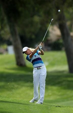 RANCHO MIRAGE, CA - APRIL 02:  Suzann Pettersen of Norway hits her second shot on the 12th hole during the second round of the Kraft Nabisco Championship at Mission Hills Country Club on April 2, 2010 in Rancho Mirage, California.  (Photo by Stephen Dunn/Getty Images)