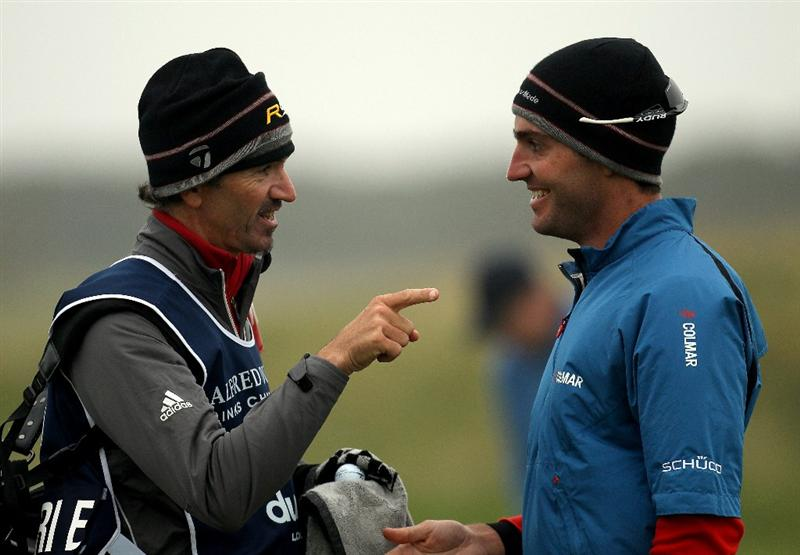 ST ANDREWS, SCOTLAND - OCTOBER 08:  Edoardo Molinari of Italy with his caddie on the 17th green during the second round of The Alfred Dunhill Links Championship at The Old Course on October 8, 2010 in St Andrews, Scotland.  (Photo by Ross Kinnaird/Getty Images)