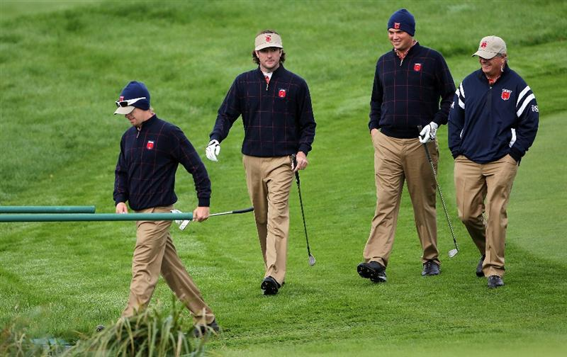NEWPORT, WALES - SEPTEMBER 30:  USA Vice Captain Paul Goydos (R) chats with Jeff Overton, Bubba Watson and Hunter Mahan (L) during a practice round prior to the 2010 Ryder Cup at the Celtic Manor Resort on September 30, 2010 in Newport, Wales.  (Photo by Jamie Squire/Getty Images)
