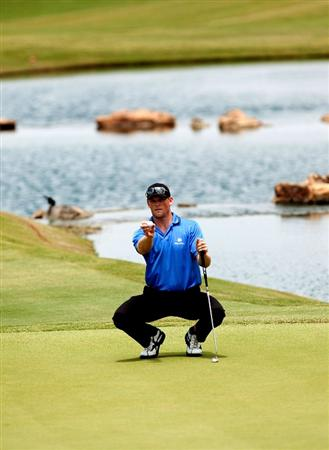 IRVING TX - MAY 22: James Driscoll lines up a putt for birdie on the 18th hole during the second round of the HP Byron Nelson Championship held at the TPC Four Seasons Resort Las Colinas on May 22, 2009 in Irving, Texas. (Photo by Marc Feldman/ Getty Images)