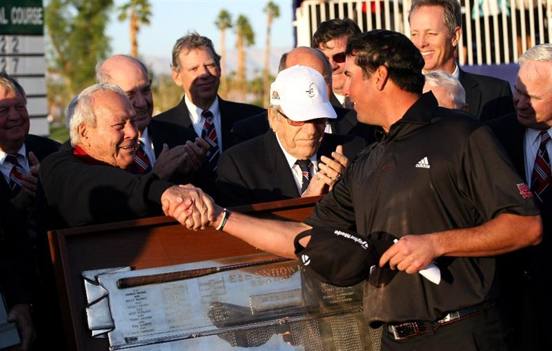 LA QUINTA, CA - JANUARY 25:  Pat Perez (R) is congratulated by tournament host Arnold Palmer after Perez' three stroke victory on the Palmer Private course at PGA West during the final round of the Bob Hope Chrysler Classic on January 25, 2009 in La Quinta, California.  (Photo by Stephen Dunn/Getty Images)