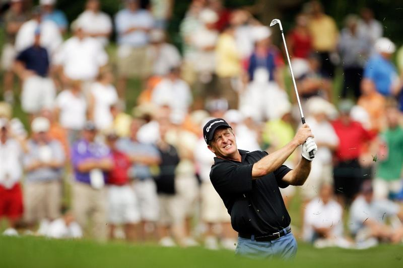 CARMEL, IN - AUGUST 01:  Fred Funk of the USA hits his second shot on the 14th hole during the third round of the 2009 U.S. Senior Open on August 1, 2009 at Crooked Stick Golf Club in Carmel, Indiana.  (Photo by Jamie Squire/Getty Images)