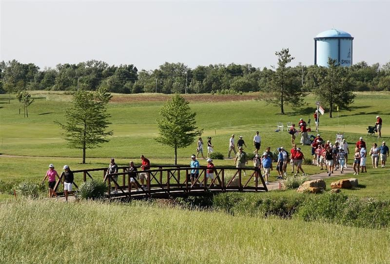 SPRINGFIELD, IL - JUNE 06: Helen Alfredsson of Sweden and Suzann Pettersen of Norway lead spectators across a bridge from the 15th hole during the third round of the LPGA State Farm Classic golf tournament at Panther Creek Country Club on June 6, 2009 in Springfield, Illinois. (Photo by Christian Petersen/Getty Images)