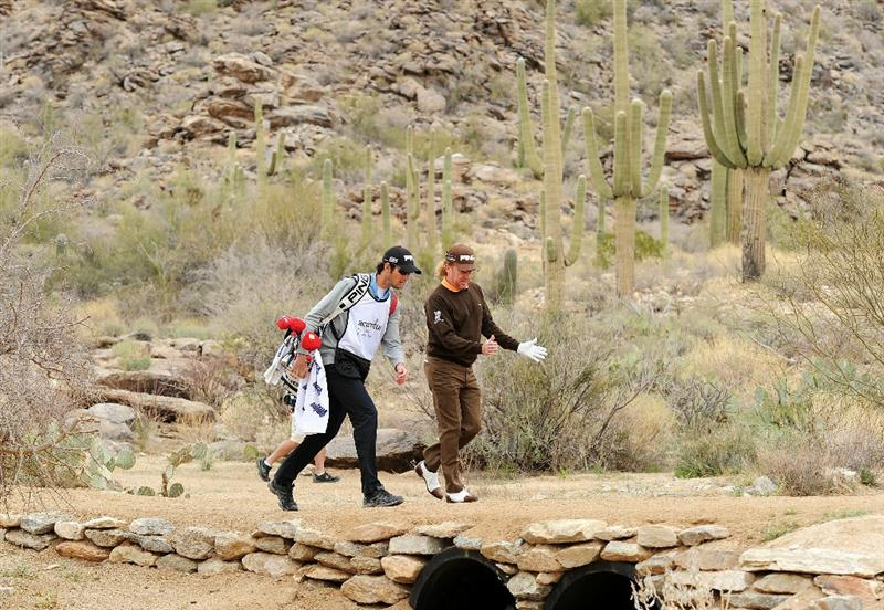 MARANA, AZ - FEBRUARY 26:  Miguel Angel Jimenez of Spain walks with his caddie on the 18th hole during the quarterfinal round of the Accenture Match Play Championship at the Ritz-Carlton Golf Club on February 26, 2011 in Marana, Arizona.  (Photo by Stuart Franklin/Getty Images)