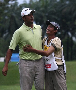 KUALA LUMPUR, MALAYSIA - MARCH 09:  Arjun Atwal of India celebrates after after the final round of the Maybank Malaysian Open held at the Kota Permai Golf & Country Club on March 9, 2008 in Kuala Lumpur, Malaysia  (Photo by Ross Kinnaird/Getty Images)