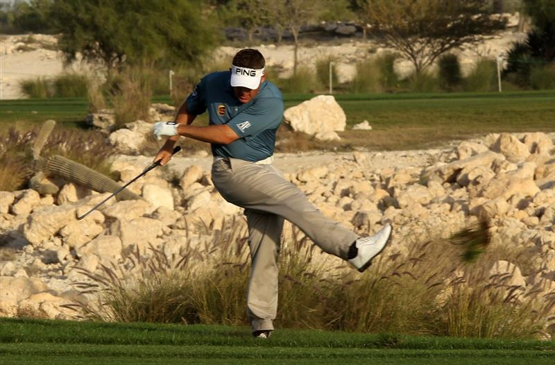 DOHA, QATAR - JANUARY 30:  Lee Westwood of England shows his frustration by kicking up a clump of grass after his second shot on the 18th hole during the third round of the Commercialbank Qatar Masters at Doha Golf Club on January 30, 2010 in Doha, Qatar.  (Photo by Andrew Redington/Getty Images)