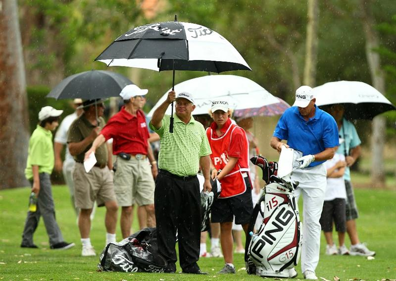 PERTH, AUSTRALIA - NOVEMBER 21:  Peter Senior and Peter Fowler of Australia wait to play their approach shots on the 4th hole during day three of the 2010 Australian Senior Open at Royal Perth Golf Club on November 21, 2010 in Perth, Australia.  (Photo by Paul Kane/Getty Images)