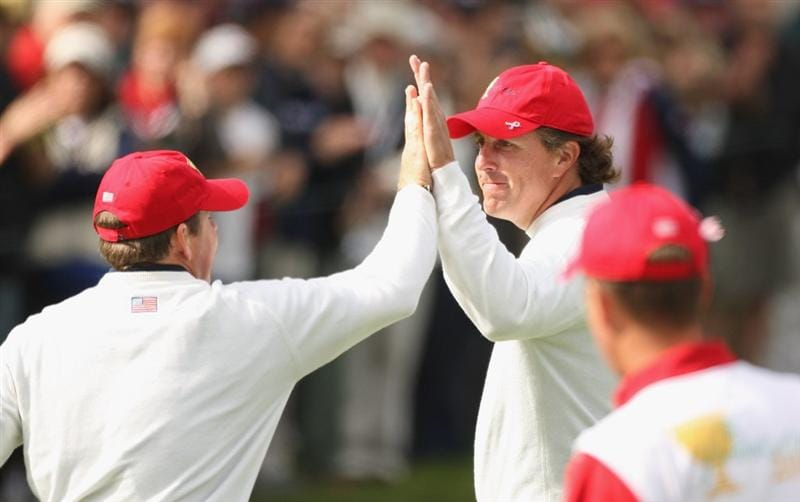 SAN FRANCISCO - OCTOBER 09:  Justin Leonard and Phil Mickelson of the USA Team celebrate winning a hole during the Day Two Fourball Matches of The Presidents Cup at Harding Park Golf Course on October 9, 2009 in San Francisco, California.  (Photo by Warren Little/Getty Images)
