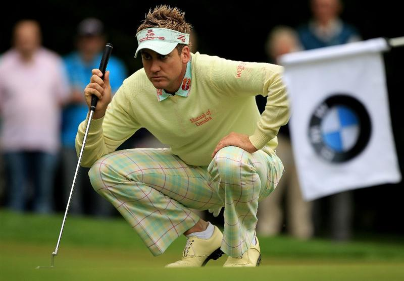 VIRGINIA WATER, ENGLAND - MAY 20:  Ian Poulter of England lines up a putt on the 1st green during the first round of the BMW PGA Championship on the West Course at Wentworth on May 20, 2010 in Virginia Water, England.  (Photo by Warren Little/Getty Images)