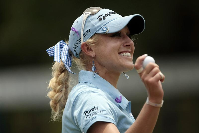 MOBILE, AL - MAY 13:  Natalie Gulbis waves after completing her first round play in Bell Micro LPGA Classic at the Magnolia Grove Golf Course on May 13, 2010 in Mobile, Alabama.  (Photo by Dave Martin/Getty Images)