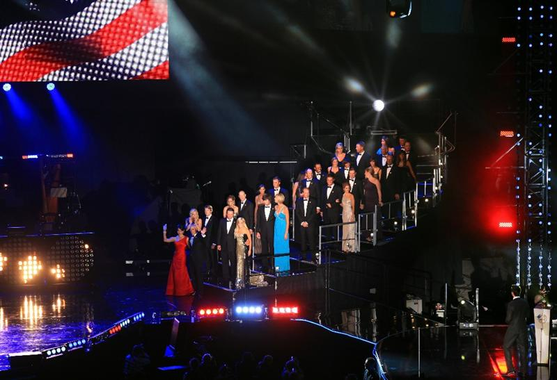 CARDIFF, WALES - SEPTEMBER 29:  The United States Ryder Cup team led by captain Corey Pavin and his wife Lisa Pavin enter the stage during Welcome To Wales Concert at Millennium Stadium on September 29, 2010 in Cardiff, Wales.  (Photo by David Cannon/Getty Images)
