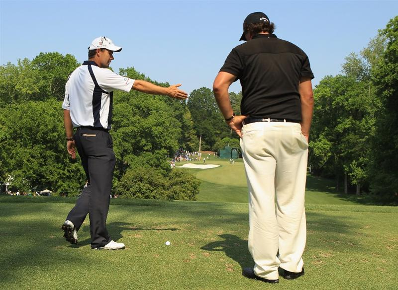 CHARLOTTE, NC - MAY 08:  Phil Mickelson (R) and Padraig Harrington of Ireland (L) look over the 13th tee box during the final round of the Wells Fargo Championship at the Quail Hollow Club on May 8, 2011 in Charlotte, North Carolina.  (Photo by Streeter Lecka/Getty Images)