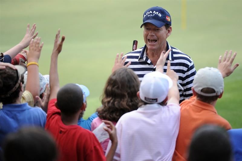 AUGUSTA, GA - APRIL 07:  Tom Watson high fives fans during the Par 3 Contest prior to the 2010 Masters Tournament at Augusta National Golf Club on April 7, 2010 in Augusta, Georgia.  (Photo by Harry How/Getty Images)