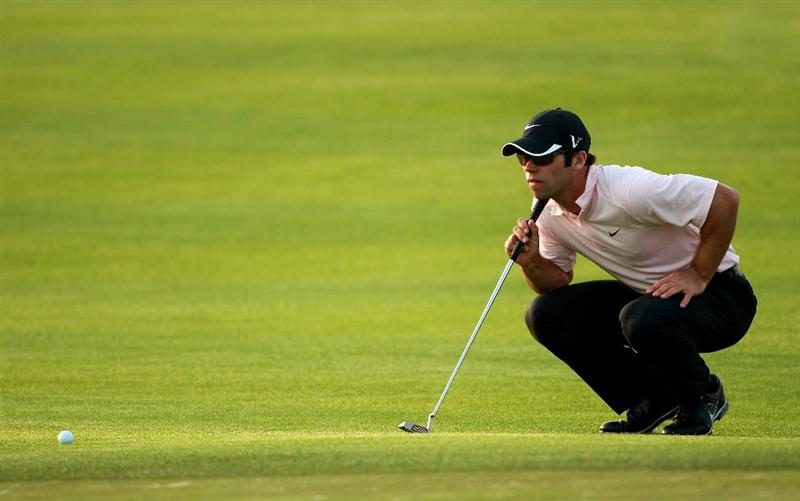 BAHRAIN, BAHRAIN - JANUARY 30:  Paul Casey of England lines up a putt on the 17th hole during the final round of the Volvo Golf Champions at The Royal Golf Club on January 30, 2011 in Bahrain, Bahrain.  (Photo by Andrew Redington/Getty Images)