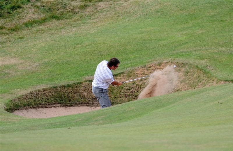 TURNBERRY, SCOTLAND - JULY 16:  Sir Nick Faldo of England plays a bunker shot on the eighth hole during round one of the 138th Open Championship on the Ailsa Course, Turnberry Golf Club on July 16, 2009 in Turnberry, Scotland.  (Photo by Harry How/Getty Images)