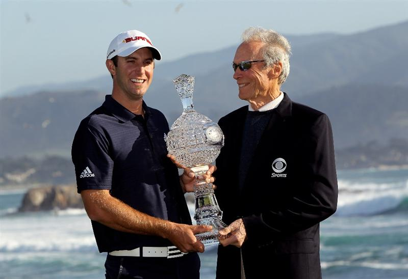 PEBBLE BEACH, CA - FEBRUARY 14:  Dustin Johnson and actor Clint Eastwood pose with the trophy after Johnson won the AT&T Pebble Beach National Pro-Am at Pebble Beach Golf Links on February 14, 2010 in Pebble Beach, California.  (Photo by Ezra Shaw/Getty Images)