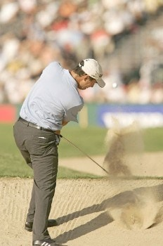 Simon Khan blasts out of the bunker during the first round of the 2005 Omega European Masters at the Crans-sur-Sierre Golf Club in Crans-Montana, Switzerland on September 1, 2005.Photo by Pete Fontaine/WireImage.com