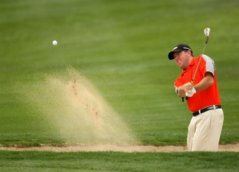 LA QUINTA, CA - JANUARY 23:  Robert Garrigus hits out ofa bunker on the 15th hole at the SilverRock Resort during the third round of the Bob Hope Chrysler Classic on January 23, 2009 in La Quinta, California.  (Photo by Stephen Dunn/Getty Images)