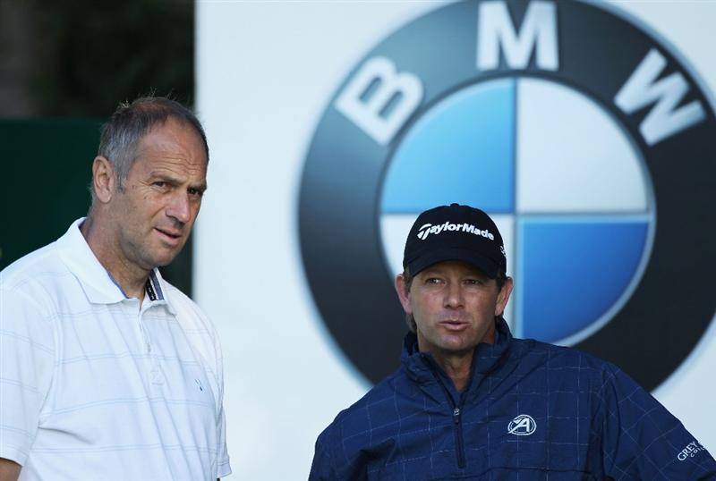 VIRGINIA WATER, ENGLAND - MAY 25:  Retief Goosen (R) of South Africa waits with Sir Steve Redgrave during the Pro-Am round prior to the BMW PGA Championship at Wentworth Club on May 25, 2011 in Virginia Water, England.  (Photo by Warren Little/Getty Images)