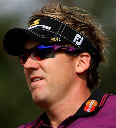 SHANGHAI, CHINA - NOVEMBER 06:  Ian Poulter of England watches his tee-shot on the second hole during the second round of the WGC-HSBC Champions at Sheshan International Golf Club on November 6, 2009 in Shanghai, China.  (Photo by Andrew Redington/Getty Images)