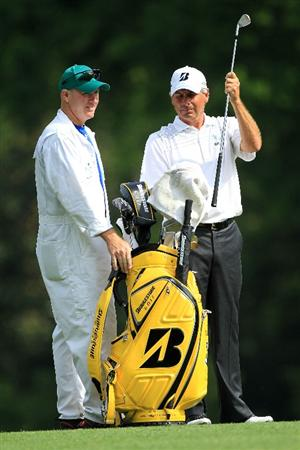 AUGUSTA, GA - APRIL 08:  Fred Couples (R) pulls a club from his bag alongside caddie Joe LaCava on the fifth hole during the second round of the 2011 Masters Tournament at Augusta National Golf Club on April 8, 2011 in Augusta, Georgia.  (Photo by David Cannon/Getty Images)
