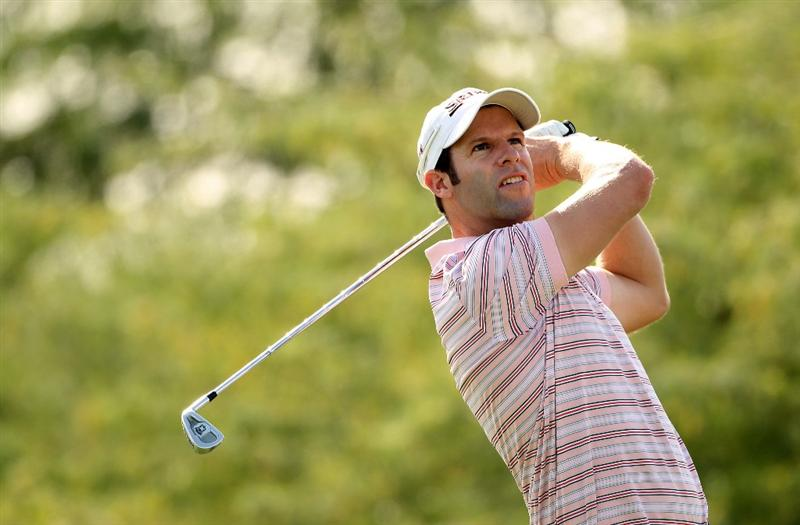 DOHA, QATAR - JANUARY 30:  Bradley Dredge of Wales hits his tee-shot on the eighth hole during the third round of the Commercialbank Qatar Masters at Doha Golf Club on January 30, 2010 in Doha, Qatar.  (Photo by Andrew Redington/Getty Images)