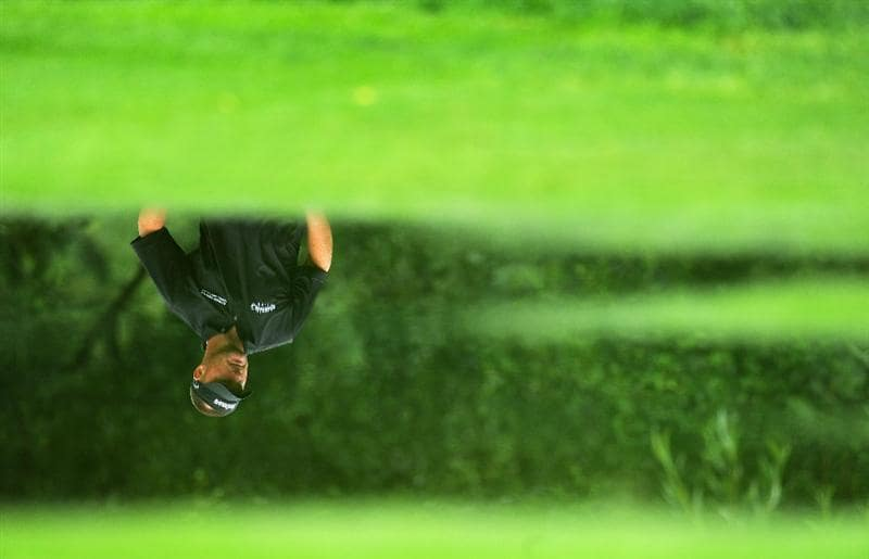 MUNICH, GERMANY - JUNE 25:  Alex Cejka of Germany is reflected in water laying on the fairway during the first round of The BMW International Open Golf at The Munich North Eichenried Golf Club on June 25, 2009, in Munich, Germany.  (Photo by Stuart Franklin/Getty Images)