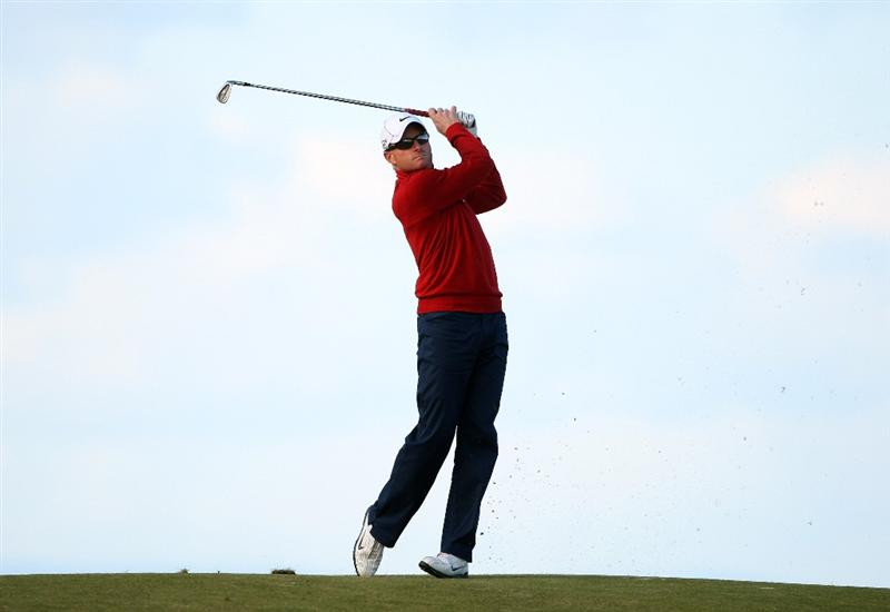 KINGSBARNS, SCOTLAND - OCTOBER 04:  Simon Dyson of England plays his second shot to the 18th green during the third round of The Alfred Dunhill Links Championship at Kingsbarns Golf Links on October 4, 2009 in Kingsbarns, Scotland.The third round was postponed on Saturday due to gale force winds.  (Photo by Andrew Redington/Getty Images)