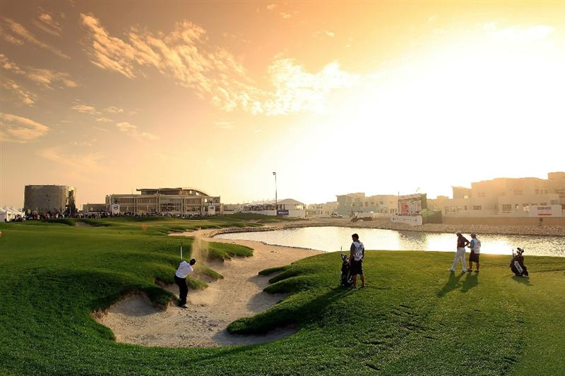 BAHRAIN, BAHRAIN - JANUARY 29: Stephen Gallacher of Scotland plays his second shot at the 18th hole during the third round of the 2011 Volvo Champions held at the Royal Golf Club on January 29, 2011 in Bahrain, Bahrain.  (Photo by David Cannon/Getty Images)