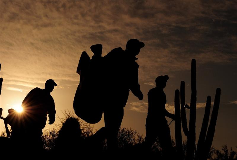 MARANA, AZ - FEBRUARY 20:  Caddies and players walk off the second hole during round four of the Accenture Match Play Championship at the Ritz-Carlton Golf Club on February 20, 2010 in Marana, Arizona.  (Photo by Stuart Franklin/Getty Images)