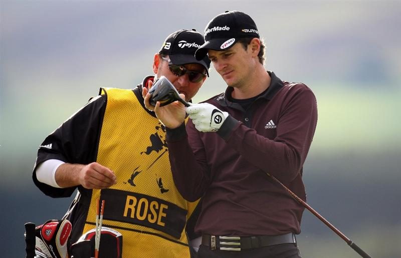 PERTH, UNITED KINGDOM - AUGUST 29:  Justin Rose of England with his caddie Mark Fulcher inspect the head of the driver on the par five 12th hole during the second round of The Johnnie Walker Championship at Gleneagles on August 29, 2008 at the Gleneagles Hotel and Resort in Perthshire, Scotland.  (Photo by Ross Kinnaird/Getty Images)
