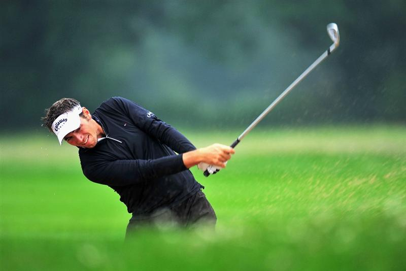 MUNICH, GERMANY - JUNE 25:  Nick Dougherty of England plays his bunker shot on the 14th hole during the first round of The BMW International Open Golf at The Munich North Eichenried Golf Club on June 25, 2009, in Munich, Germany  (Photo by Stuart Franklin/Getty Images)