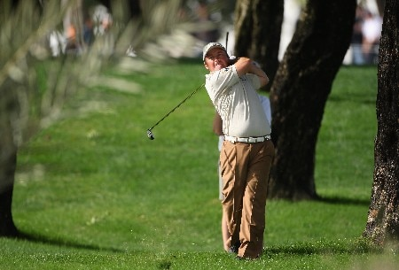 DUBAI, UNITED ARAB EMIRATES - FEBRUARY 02:  Damien McGrane of Ireland hits his second shot on the tenth hole during the third round of the Dubai Desert Classic on the Majilis course at Emirates Golf Club on February 2, 2008 in Dubai, United Arab Emirates.  (Photo by Andrew Redington/Getty Images)