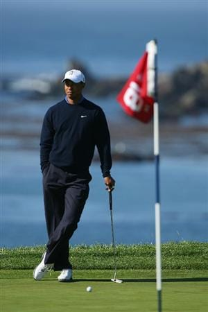 PEBBLE BEACH, CA - JUNE 16:  Tiger Woods looks on during a practice round prior to the start of the 110th U.S. Open at Pebble Beach Golf Links on June 16, 2010 in Pebble Beach, California.  (Photo by Donald Miralle/Getty Images)