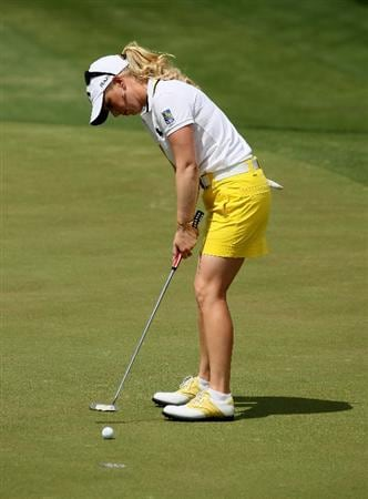 RANCHO MIRAGE, CA - APRIL 02:  Morgan Pressel putts on the second green during the third round of the Kraft Nabisco Championship at Mission Hills Country Club on April 2, 2011 in Rancho Mirage, California.  (Photo by Stephen Dunn/Getty Images)